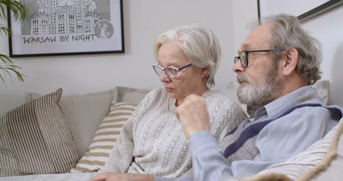 Elderly Couple Watching Television Together