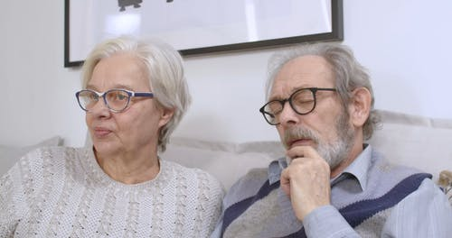 Elderly Couple Fighting Over a Remote Control