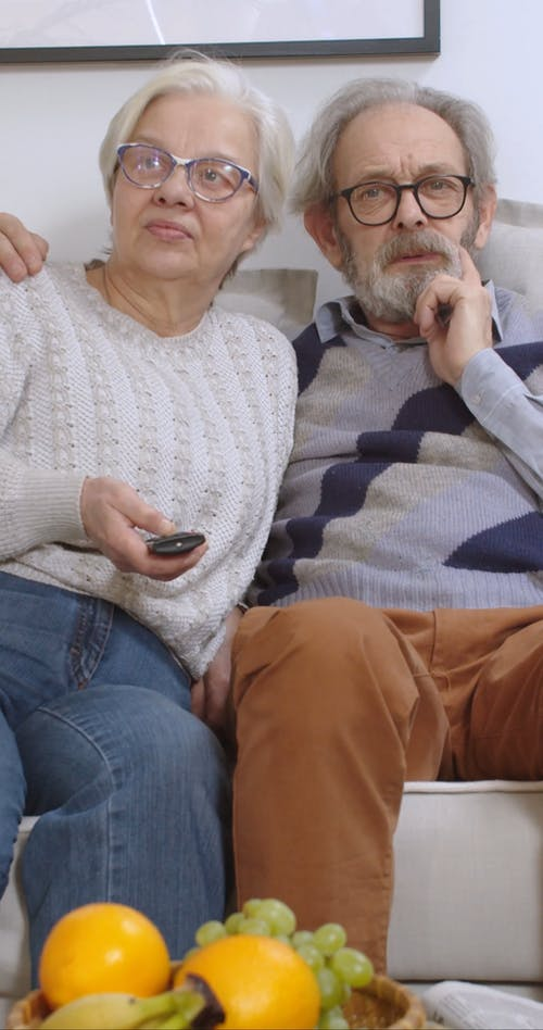 Elderly Couple Watching Together