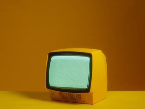 A Young Man Posing With A Television