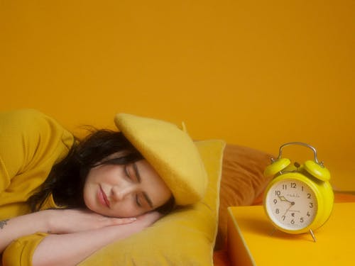 A Sleeping Woman Awoke By The Alarm Clock