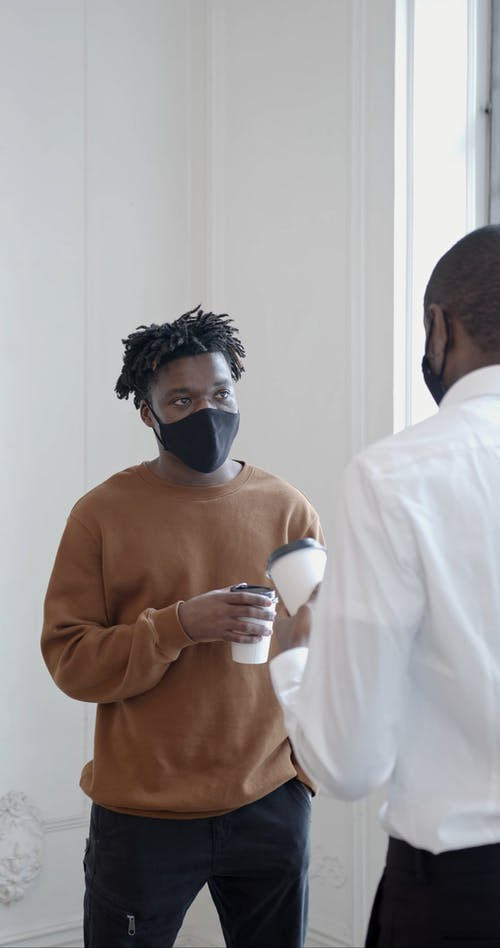 Men Talking to Each other with Social Distancing and Wearing Facemask