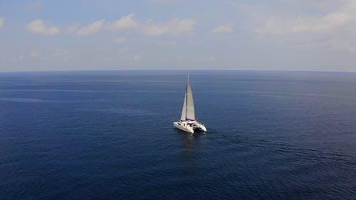 Sail Boat in Blue Sea