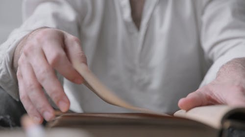 Male Hands Flipping Book Pages
