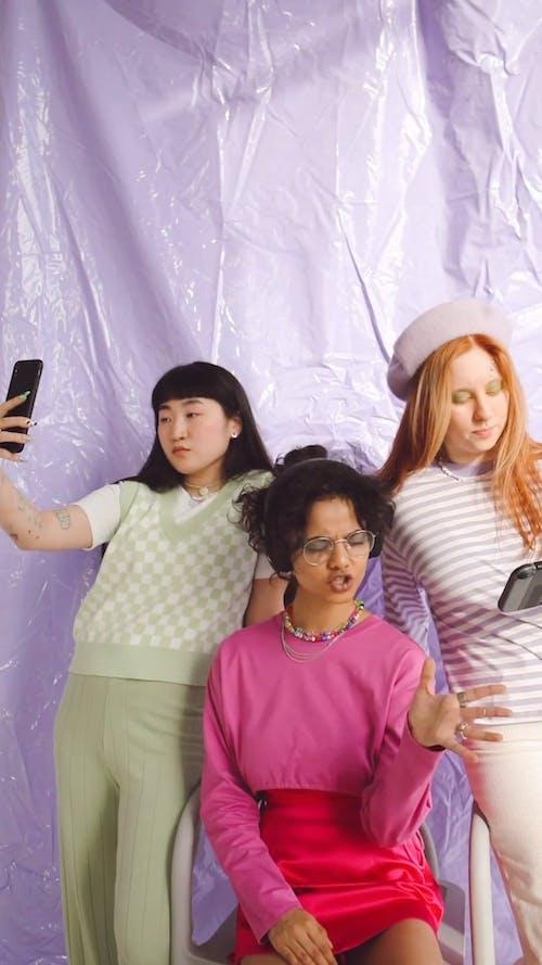 Three Young Women on Light Purple Background