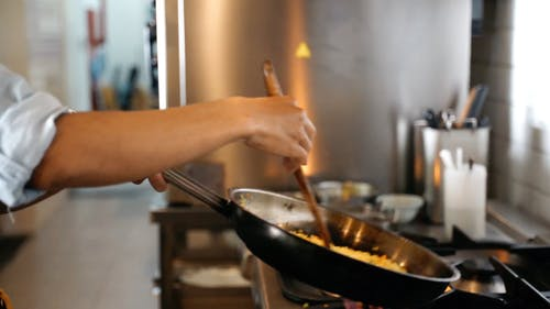 Close-Up View of a Person Cooking