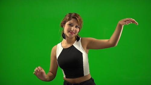 Woman Dancing Cheerfully