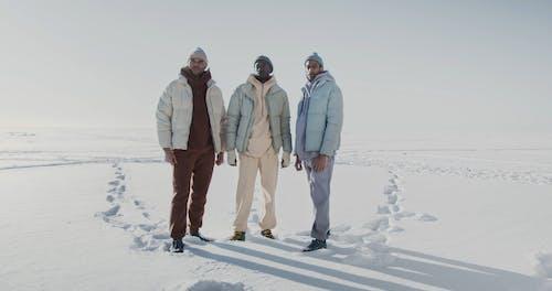 Men Standing in the Snow