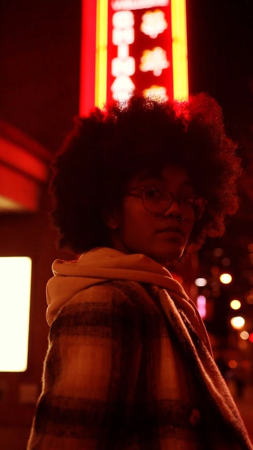 Woman with Afro Hair Turning Around