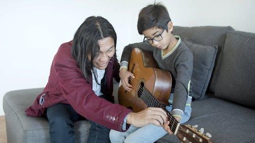 Man Teaching Guitar Lesson