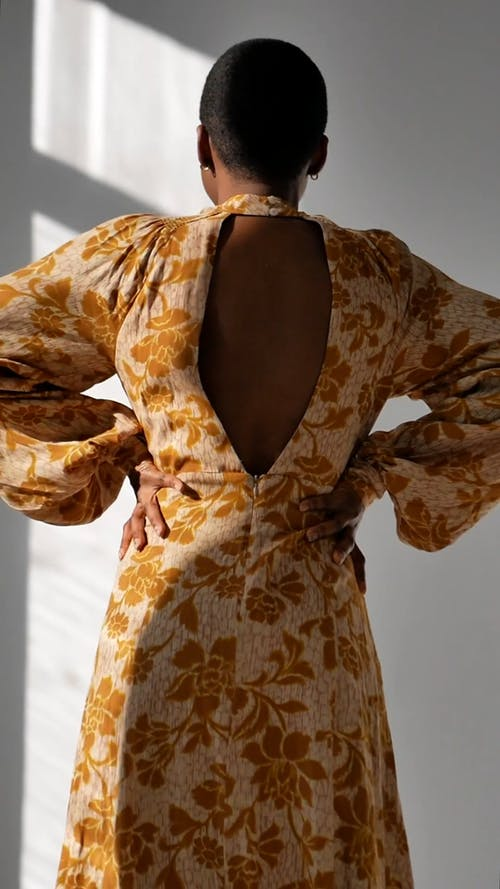Back View of a Woman Modeling a Yellow Dress
