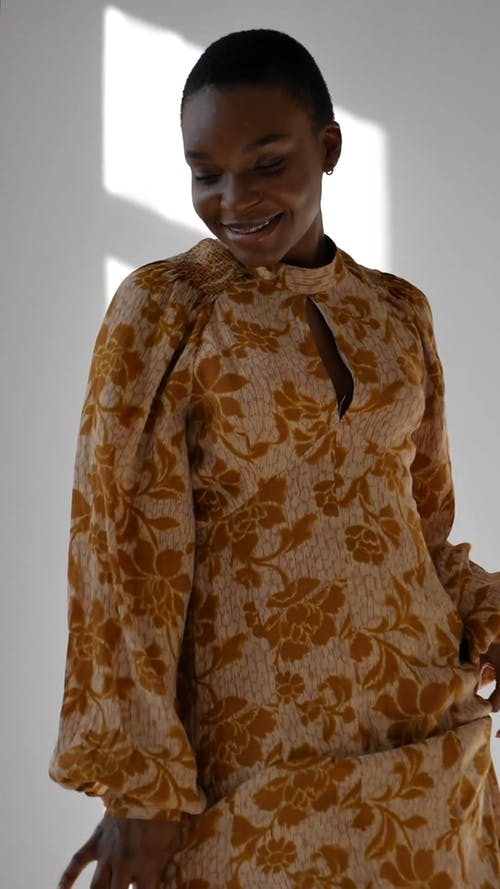 Video of a Woman Wearing a Dress