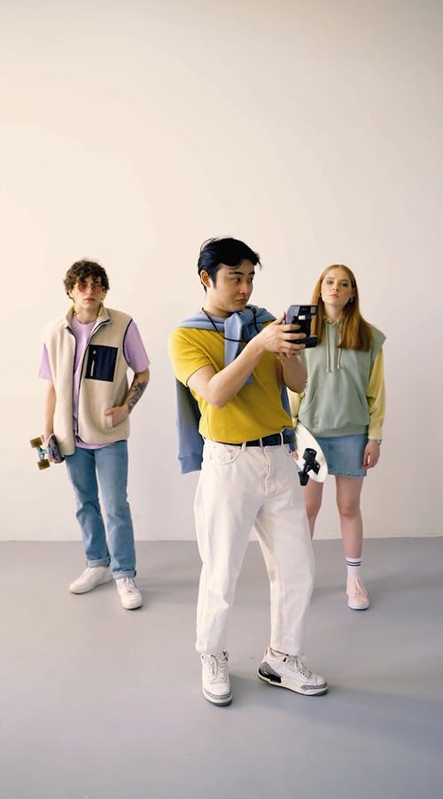 A Group of People Posing and Modeling