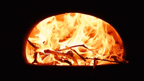 Burning Logs in a Fireplace