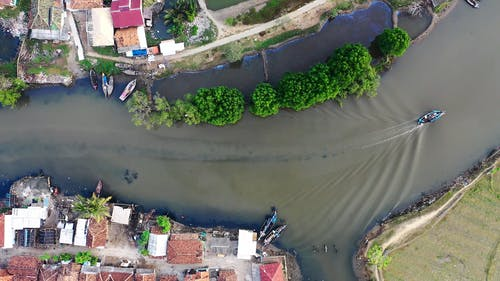 Drone Shot of Boat Travelling Through Water