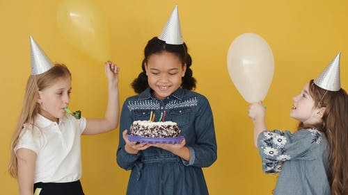 Girl Celebrating Her Birthday Party with Her Friends
