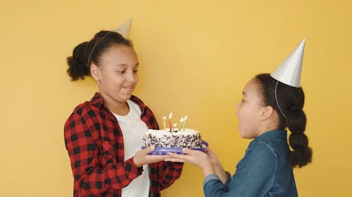 Girl Celebrating Her Birthday with Her Sister
