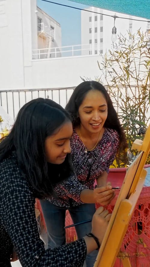 Mother and Daughter Painting an Artwork