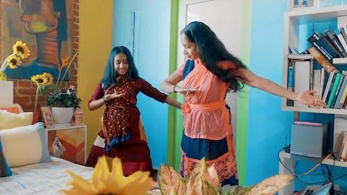 Mother Teaching Daughter Dance Steps