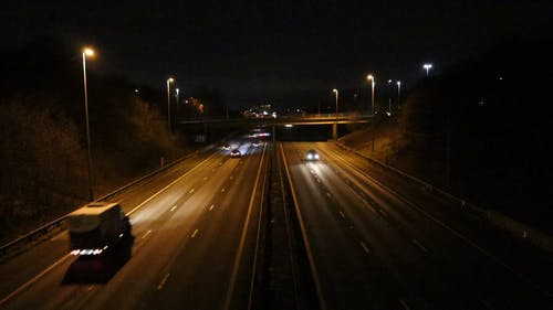 Vehicles Passing by the Expressway at Night