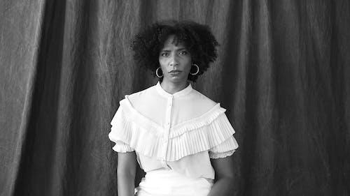 Serious Woman Wearing White Clothing