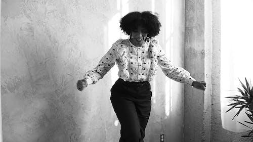 Woman in White Top Dancing