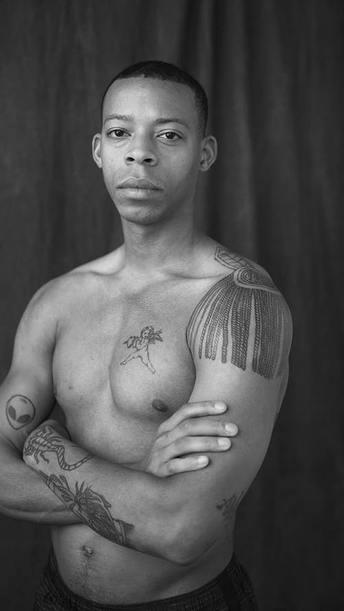 Shirtless Man With Arms Crossed