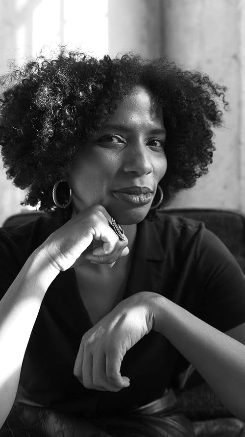 Woman with Afro Hair Looking at Camera