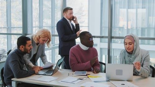 Businesspeople Having Conversation in Office