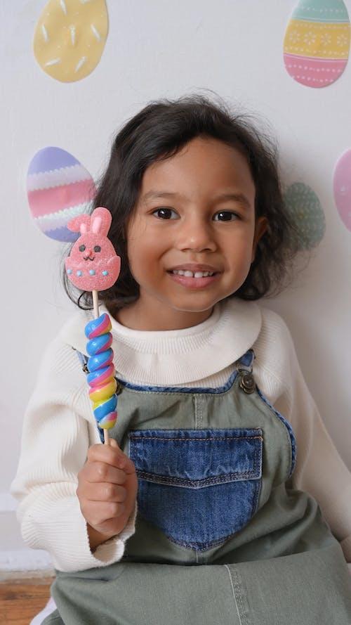 A Little Girl Holding a Lollipop