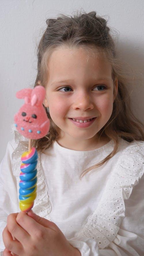 A Little Girl Holding a Bunny Lollipop