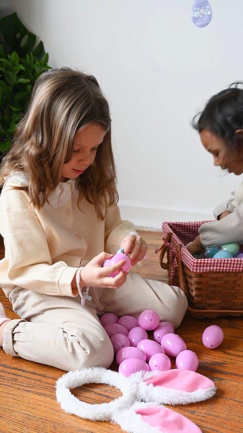 Girls Holding Eggs