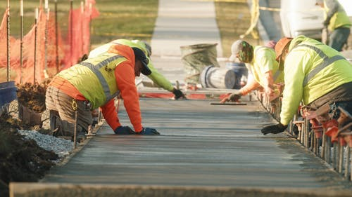 Construction Workers Fixing a Road