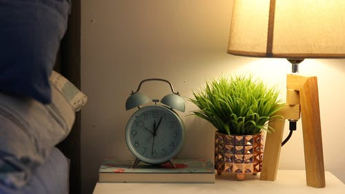A Person Activating an Alarm Clock