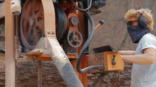 Man Using a Wood Cutting Machine