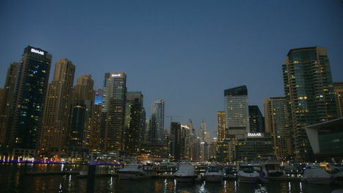 A Low Angle Shot of Buildings and Docked Yachts