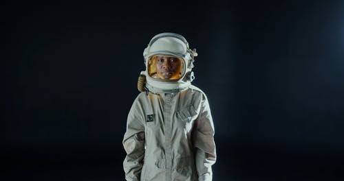 A Woman Closing Her Space Helmet Cover