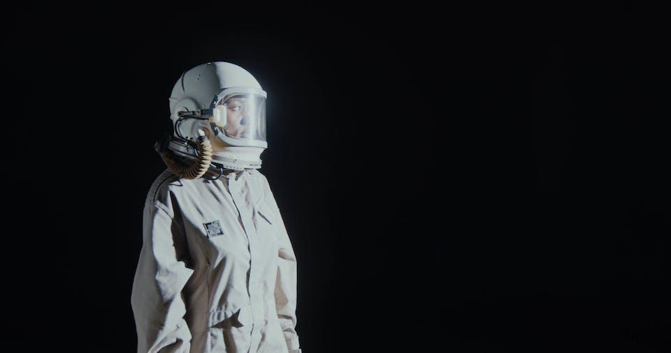 A Woman Wearing A Space Helmet