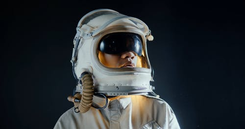 A Woman Wearing A Space Helmet With Sunvisor
