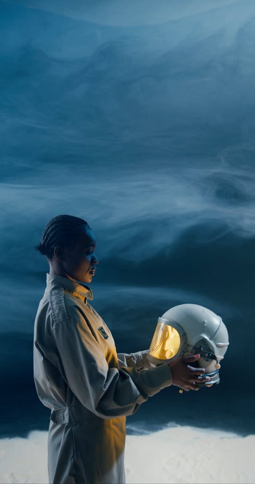 A Woman Holding A Space Helmet