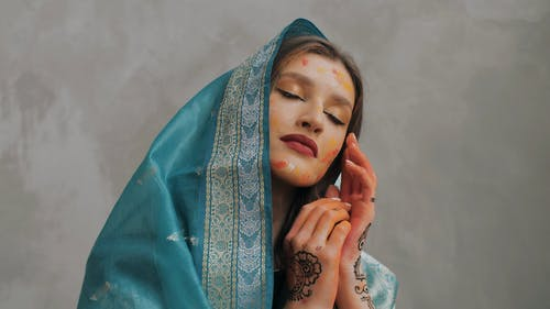 Woman Model with Face Paint and Headscarf