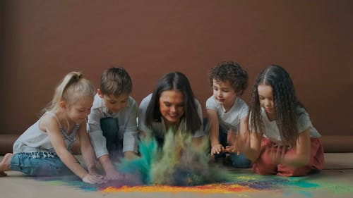 A Family Having Fun with Colored Powders