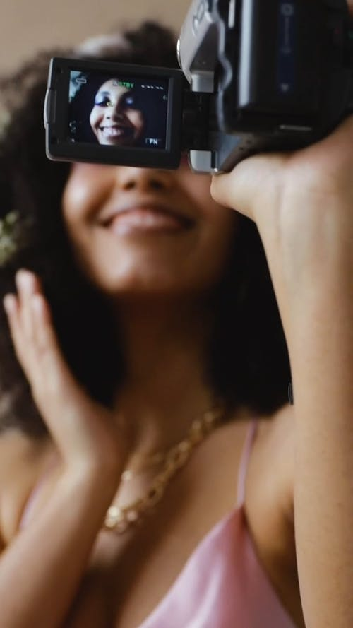 A Woman Filming Herself