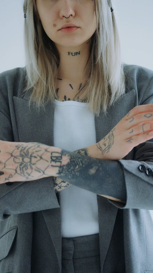 Woman with Tattoo in Business Suit