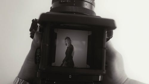 Woman in a Camera Viewfinder