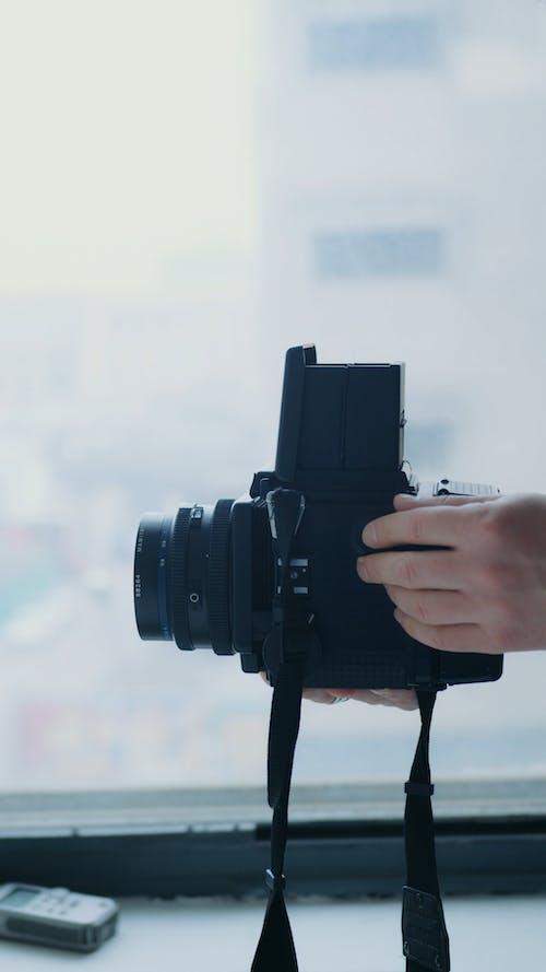 Photographer Adjusting the Camera Settings