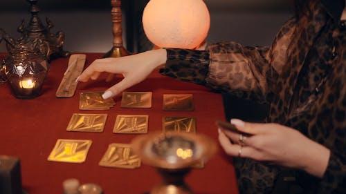 A Woman Using Tarot Cards