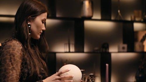 Fortune Teller Holding a Illuminated Ball