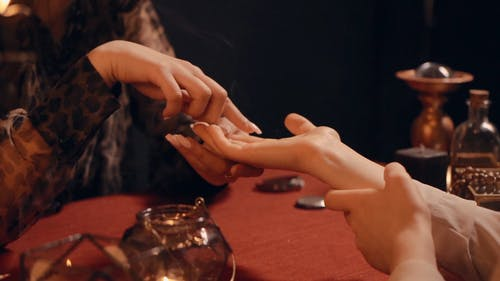Fortune Teller Reading the Palm of the Woman