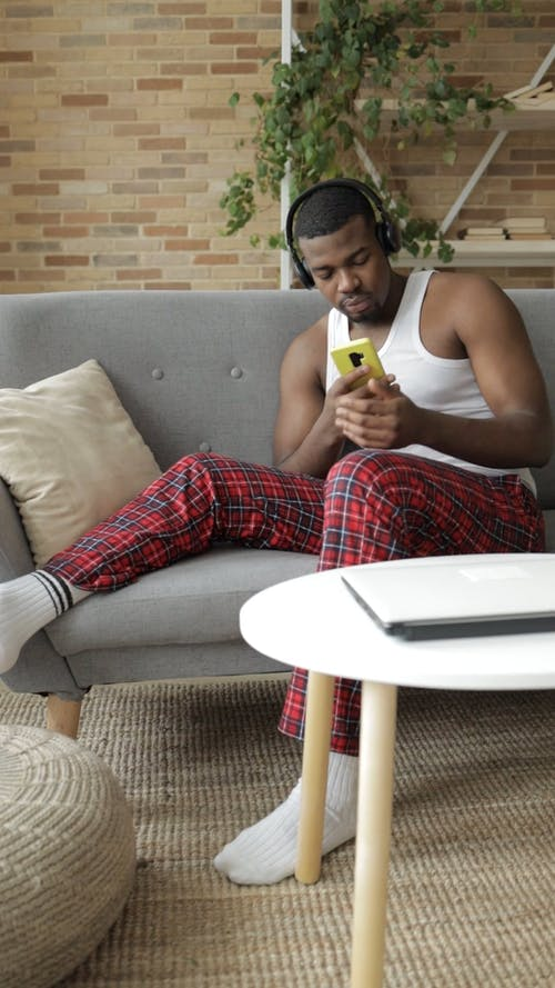 Man Sitting on a Couch